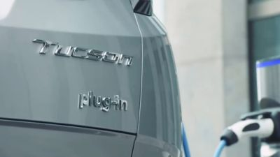 The all-new Hyundai TUCSON Plug-in Hybrid SUV pictured from the back.